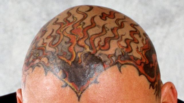 Top 15 coolest wwe superstar tattoos wrestling amino for Corey graves tattoos