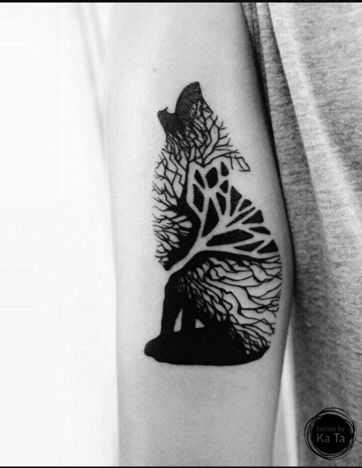 467a6ecac Tattoos: a tattoo of a Wolf made of tree branches on his left arm