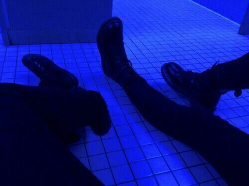 In The Cold Blue Light Of A Bathroom