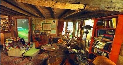 The Inside Of Burrow Was Comforting And Welcoming With A Fireplace Large Kitchen Cozy Living Room It Perfect For Weasley Family