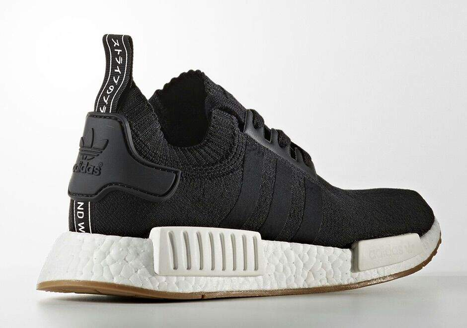 8582c14d012 The Adidas nmd R1 gum pack features two similar colorways of this dope  runner shoe. Both feature Primeknit uppers in either black or white.