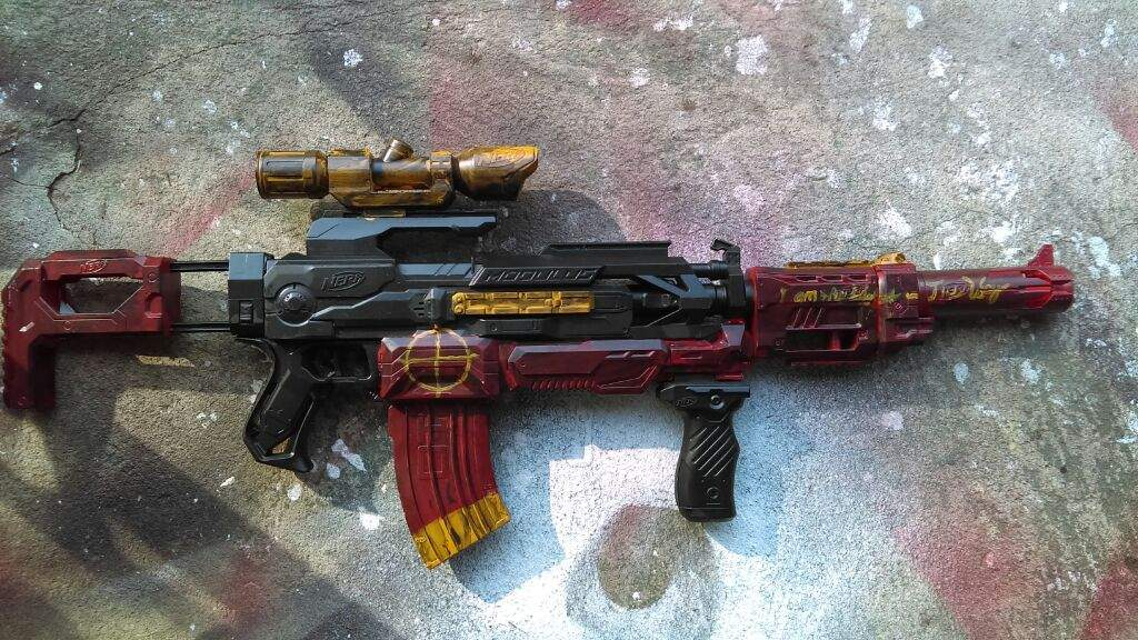 I just put a couple of Nerf gun parts together and added the right paint  colors, and here it is!