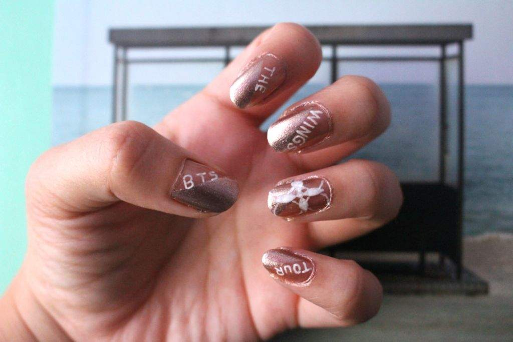 bts wings tour nail art armys amino i used a metallic gold nail polish as a base then used tape to help me make a diagonal design with a more shimmery gold color then i drew the wings tour prinsesfo Choice Image