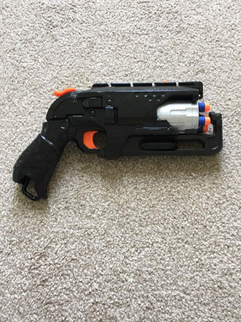 I took a hammershot (nerf gun) and disassembled it. I gave it a paint job  (and messed with the insides) (yes, it still shoots, in fact I improved the  ...