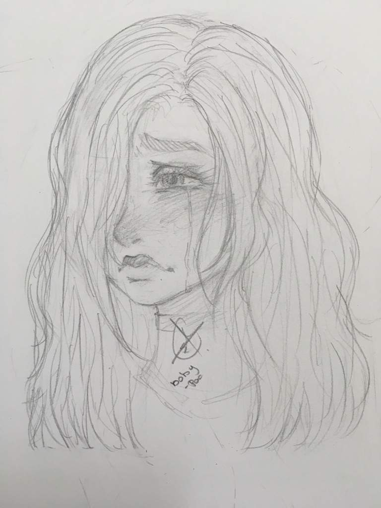 A girl crying drawing