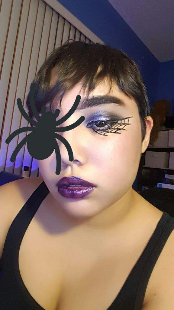 up as the black spider aka magic brian from the adventure zone podcast and she did a test for her makeup only one eye done hence the spider sticker