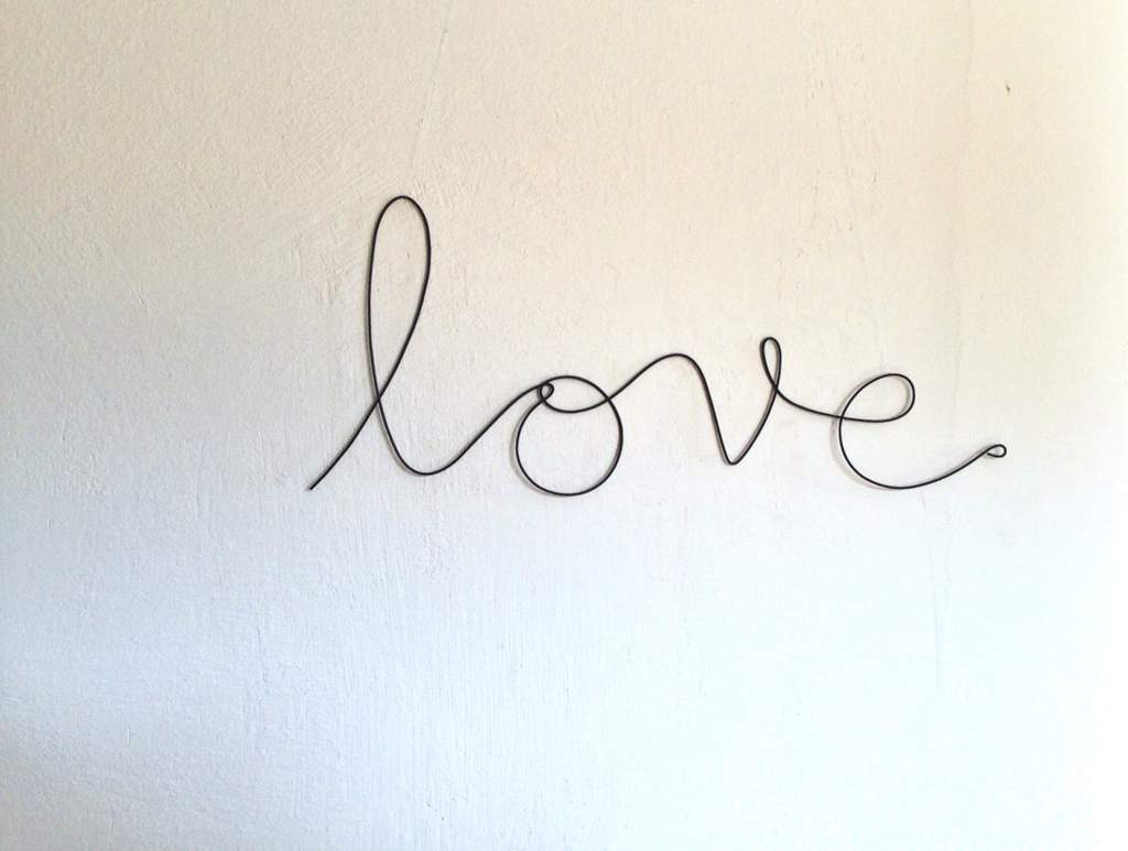 I Am Going To Have The Work Love In Cursive And Have The Simple Wave Put Into The End Of The Word