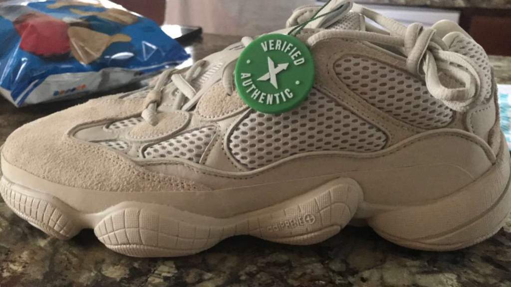 """5d2a815f75010 This tag would mean that the shoe is legitimate because of they were  verified by their """"shoe experts"""""""